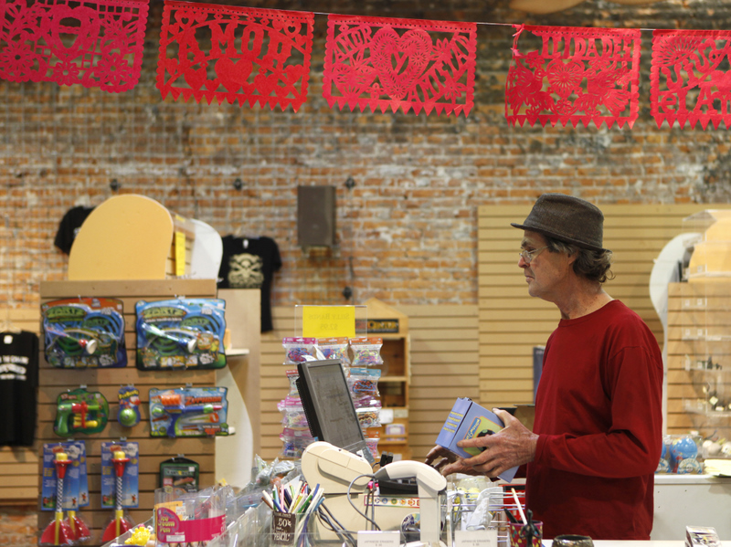 Wayne Morgenthaler liquidates the inventory of his Jungle Vibes Gift & Toy Emporiuim. (Beth Schlanker / Press Democrat)