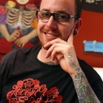 Tattoo artist Jimmy Bruce at Aces Over Eights in Petaluma. (Jeff Kan Lee / Press Democrat)