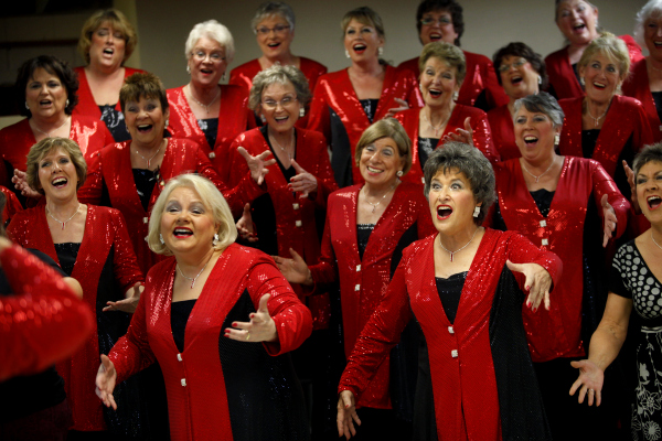 Members of the Pacific Empire Chorus including Lynn Carlson, front row left, and Marbeth Hanamura, right, sing together during a dress rehearsal at the First Presbyterian Church of Petaluma. (BETH SCHLANKER/ The Press Democrat)