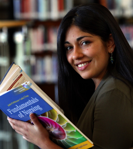 Gabby Salinas at SRJC's Petaluma campus library. (Jeff Kan Lee / The Press Democrat)