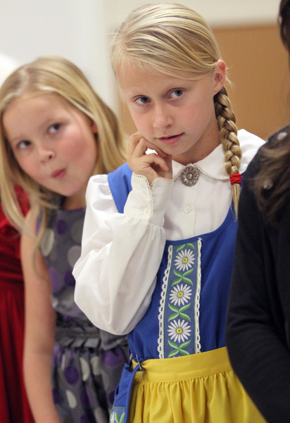 Emily Johansseon, 9, right, and Audrey Powers listen to instructions as they rehearse their performance at the Linnea Lodge's annual Lucia festival. (Christopher Chung/ The Press Democrat)