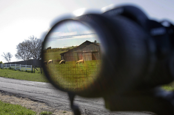 A barn is reflectd in the lens of Jim Bracco of Rohnert Park as he takes aim at his favorite subject, old barns, along Davis Lane in Penngrove. (Scott Manchester / Press Democrat)