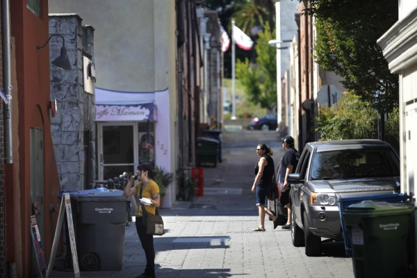 Pedestrians make their way through American Alley. (BETH SCHLANKER/  The Press Democrat)