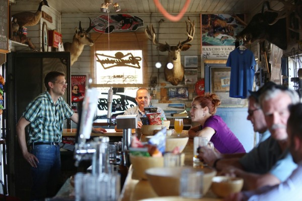Ernie Altenreuther, left, talks with regulars at Ernie's Tin Bar in Petaluma.