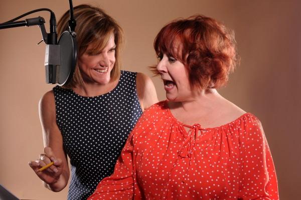 Samantha Paris guides voice actor Maureen O'Donoghue through a script. Photo courtesy of Samantha Paris.