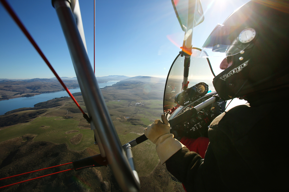 Michael Globensky with Spirits Up Open Air Flying School flies over Tomales Bay in his motorized glider on Sunday, Dec. 22, 2013. Globensky teaches how to fly these trikes while also providing discovery tours around Sonoma County. (Conner Jay / The Press Democrat)