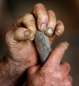 Gordon Swenson's 71-year-old hands.