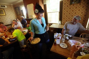 Emily Drew, the manager and granddaughter of the owner, serves up traditional American meals a the Washoe House.